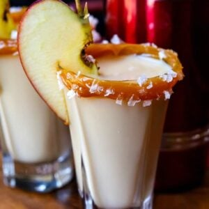 caramel apple shots with a shaker on a tray