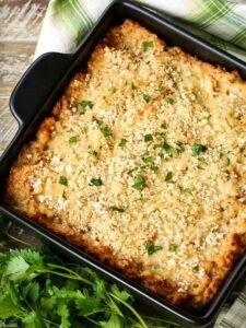 cauliflower gratin with fresh parsley and a green and white napkin