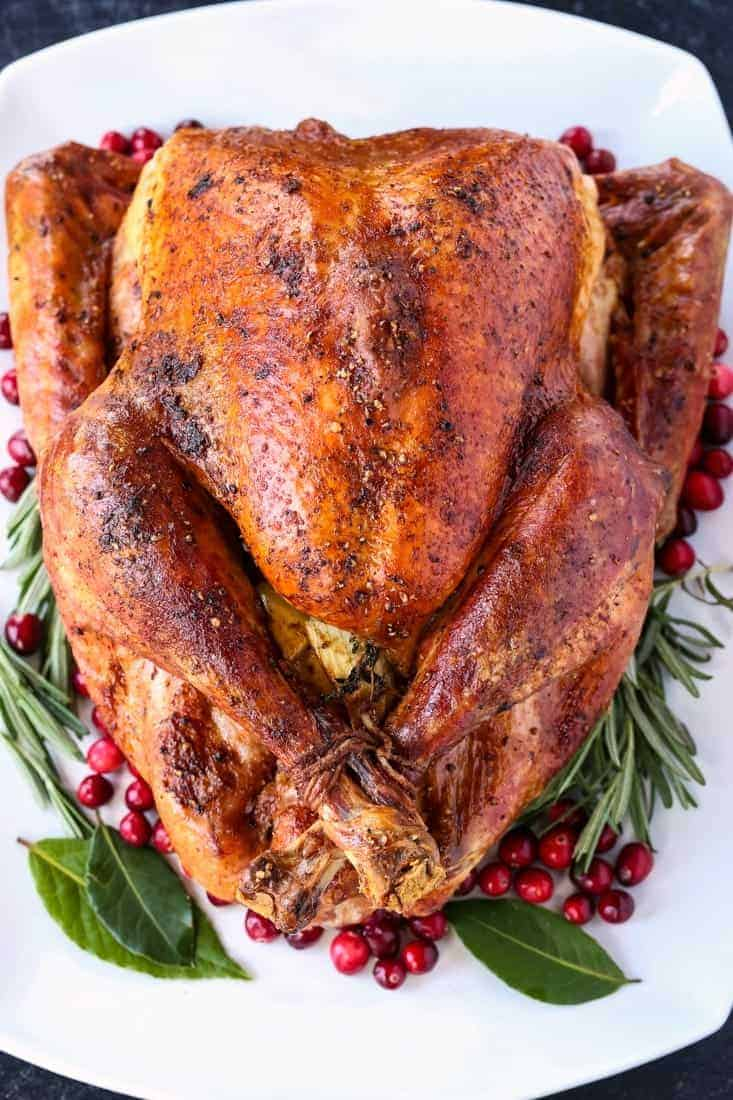whole roast turkey on a white platter