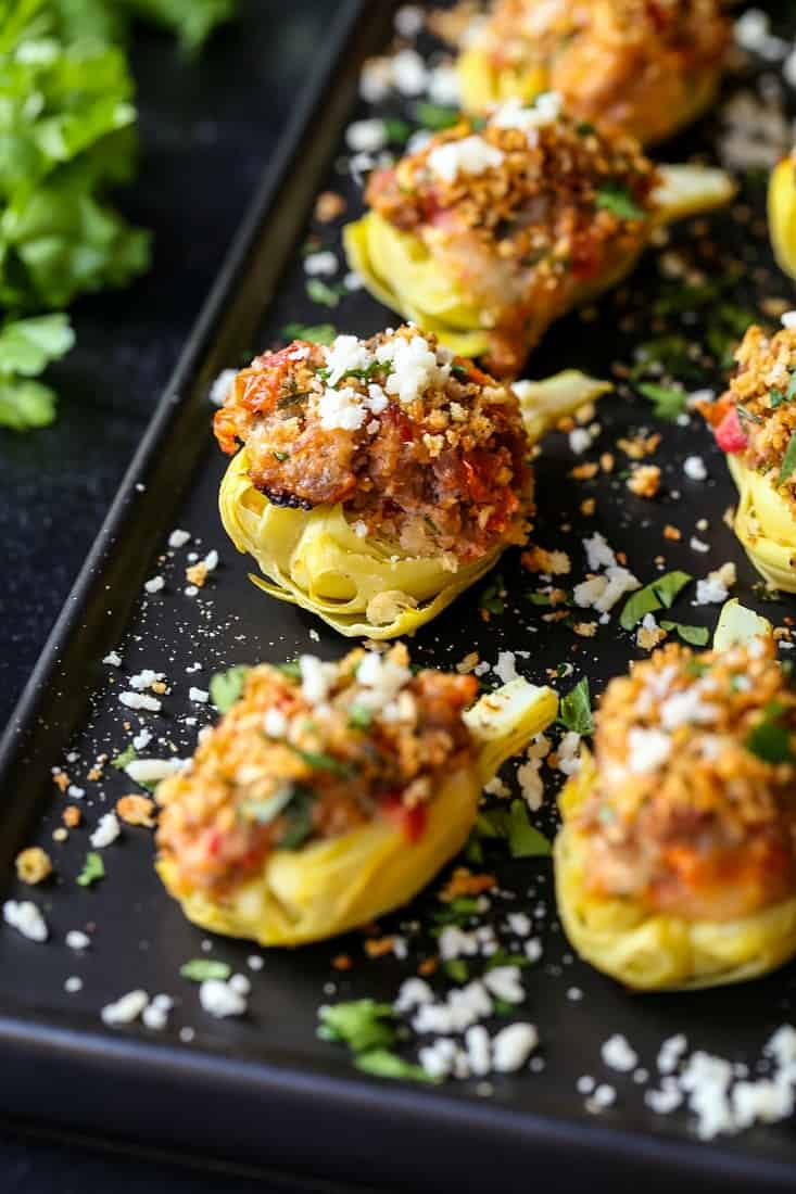 stuffed artichoke hearts with sausage, cheese and a bread crumb topping