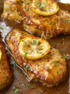This easy chicken recipe is simmered in a lemon sauce with wine