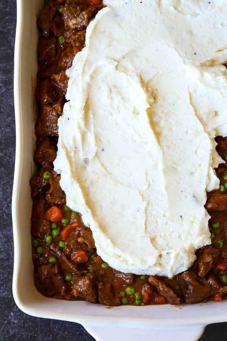 Beef Shepherd's Pie recipe getting topped with mashed potatoes