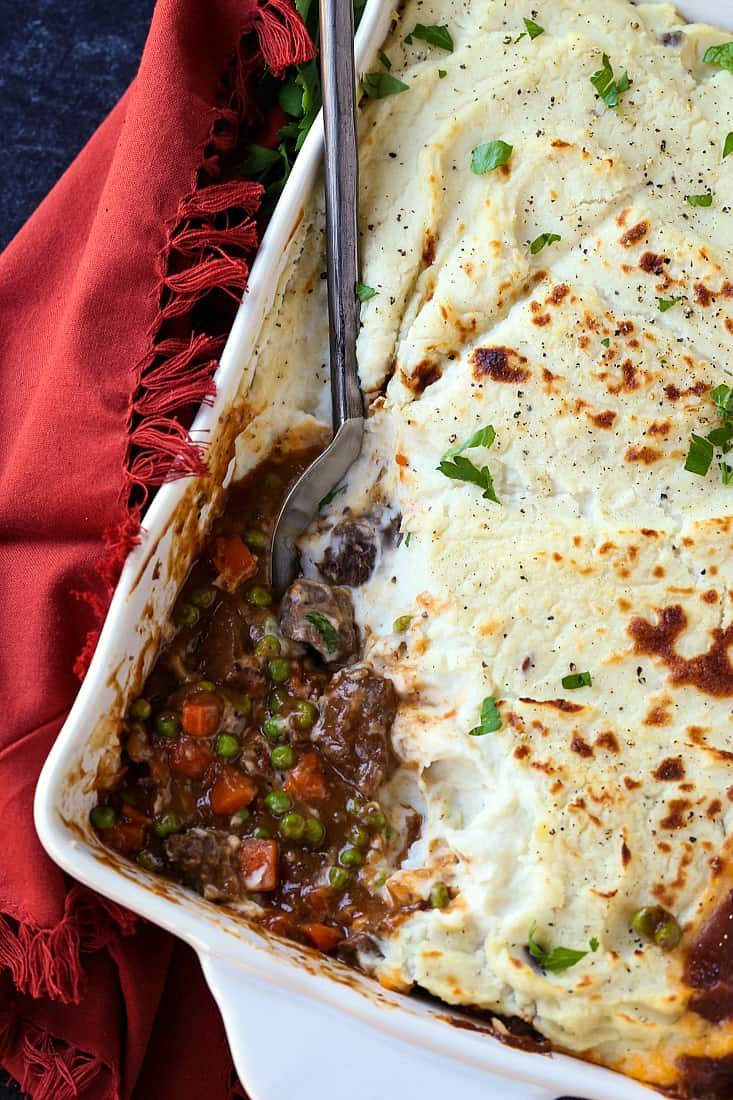 Guinness Beef Shepherd's Pie with a spoon in the casserole dish