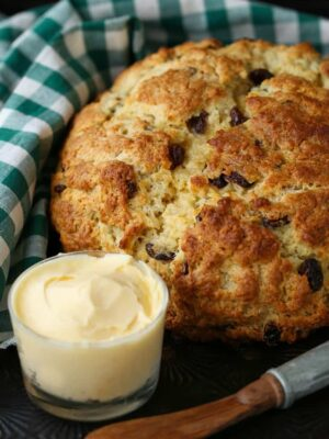 Irish Soda Bread recipe with butter and a knife