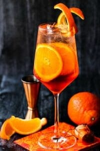 An Perol Spritz Cocktail on a dark background