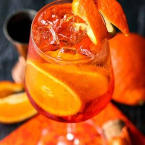 A champagne cocktail made with Aperol and fresh orange