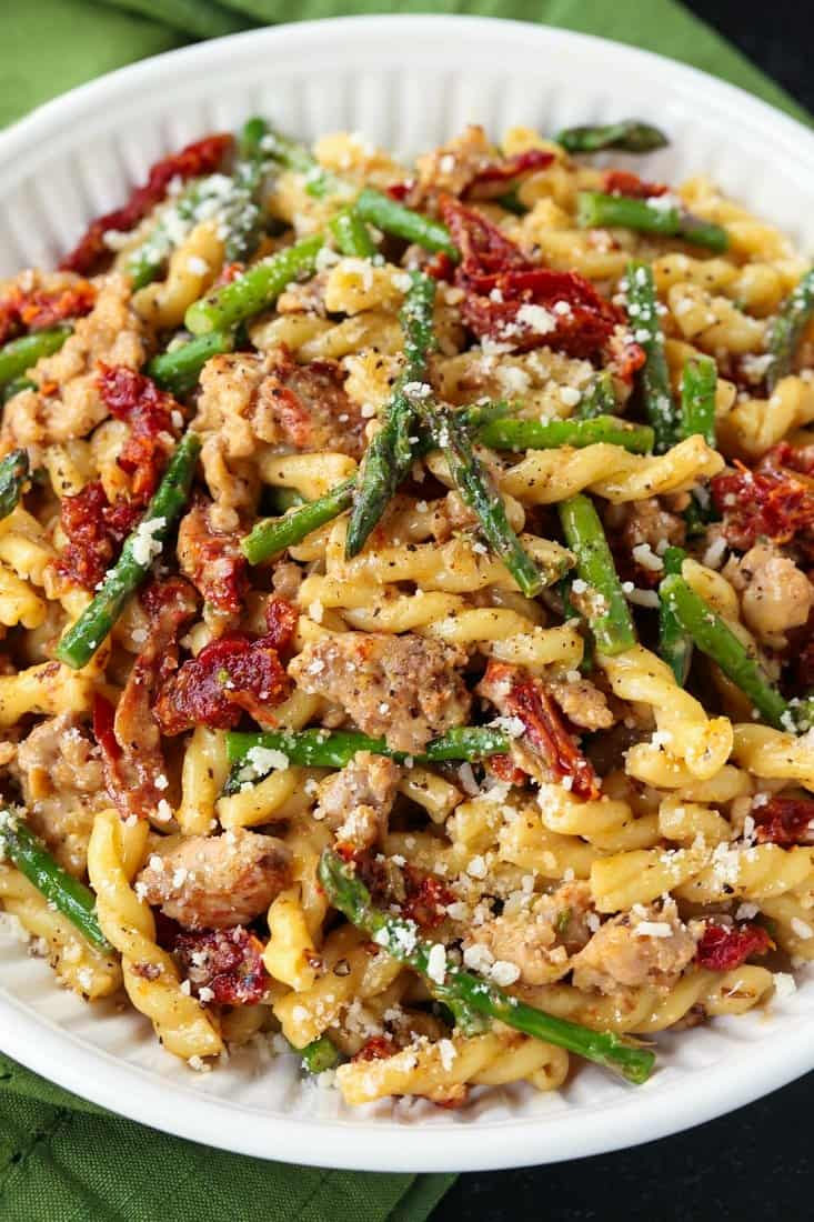 Gemelli with Sausage and Asparagus in a white bowl