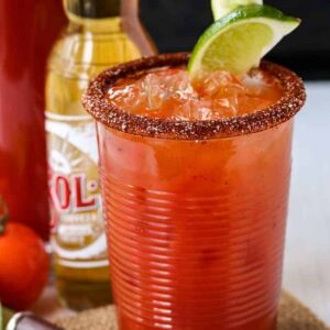 A Michelada cocktail with a spice rim