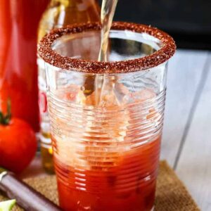 Beer pouring into a glass to make a Michelada