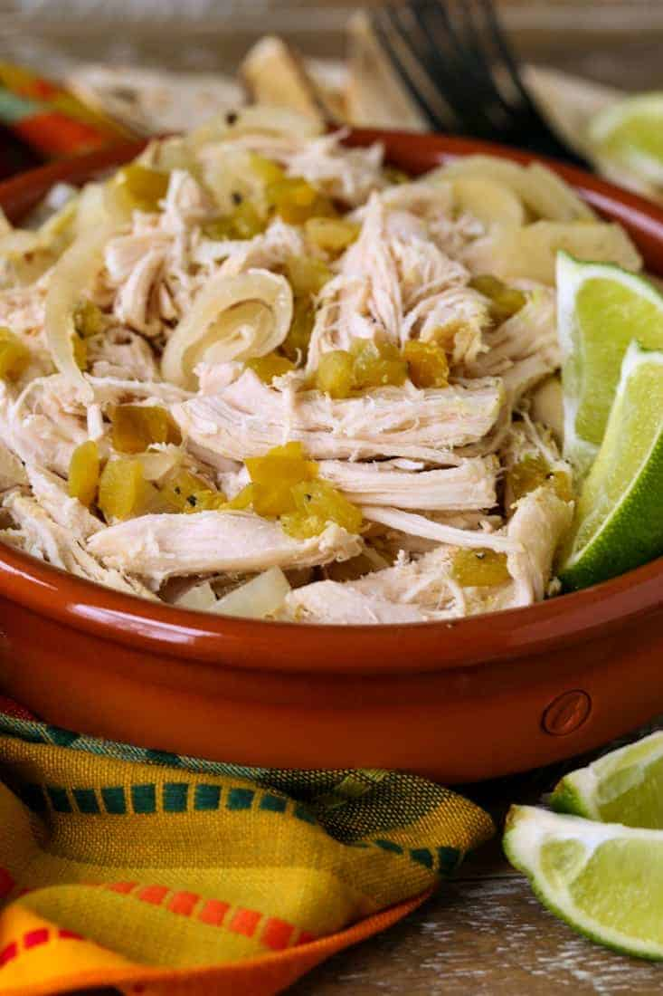 Slow Cooker Shredded Chicken in a bowl with a colorful napkin