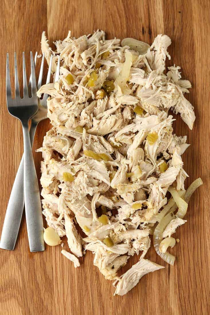 Slow cooker Mexican Chicken on a board with forks