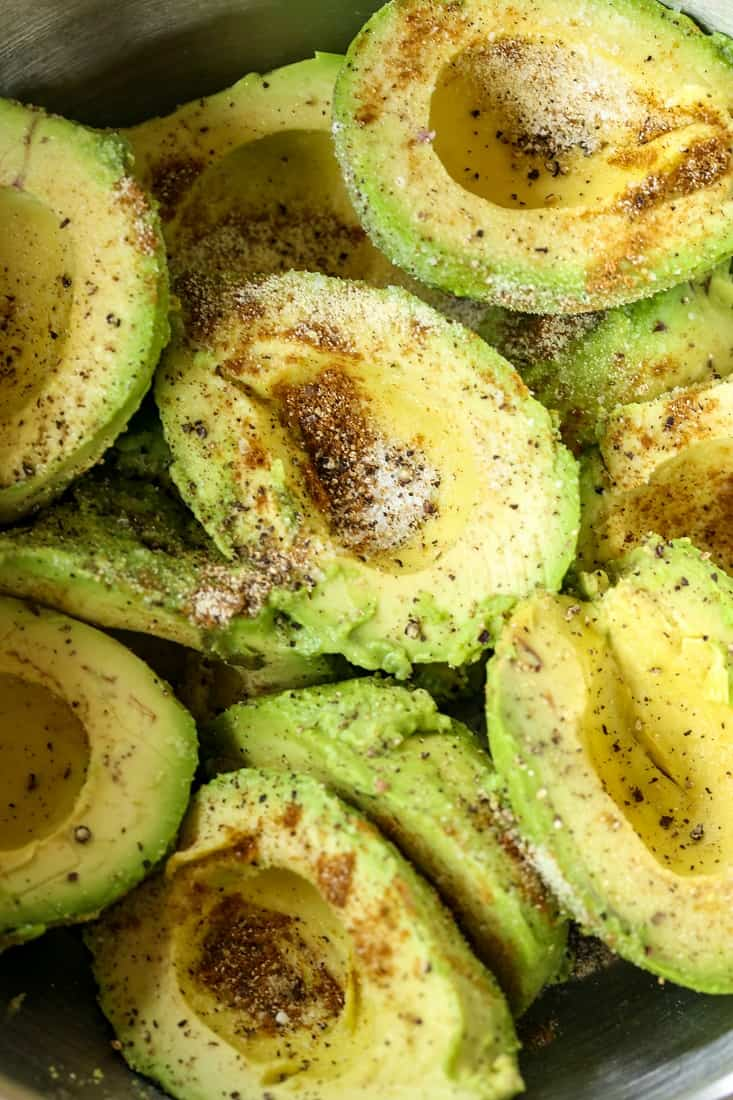 Avocados in a bowl to make homemade guacamole