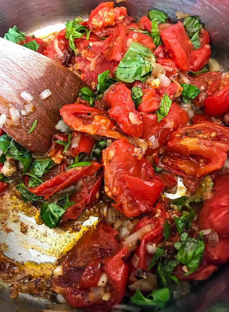 Roasted tomatoes and fresh basil to make tomato soup recipe