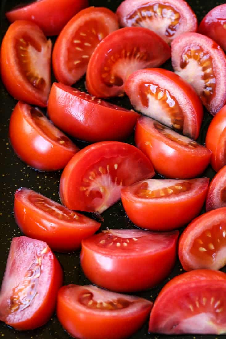 tomatoes on a sheet pan for roasting