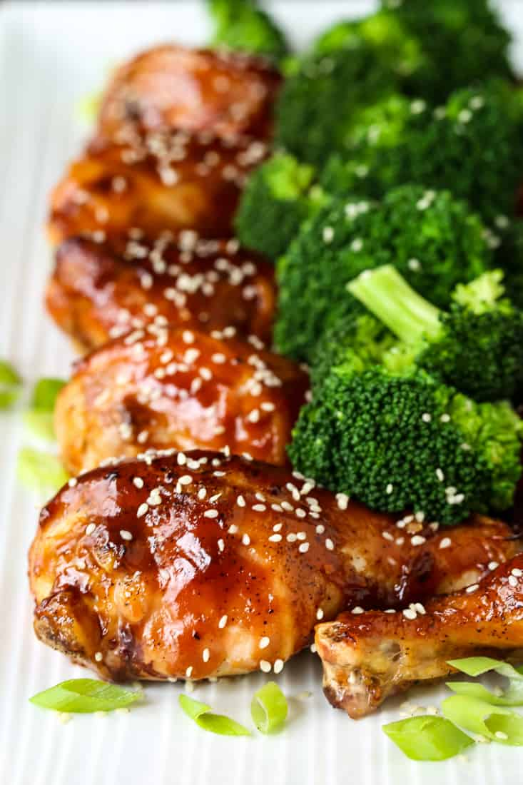 Chicken legs baked with an Asian flavored glaze served with broccoli