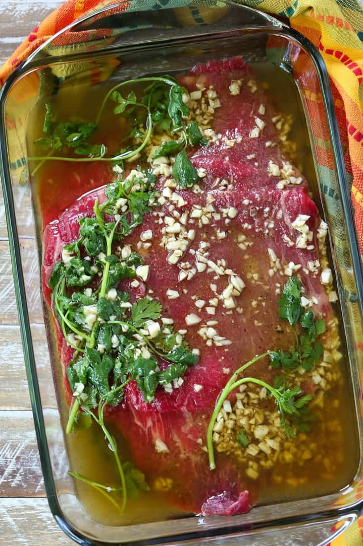 Flank steak in dish with marinade