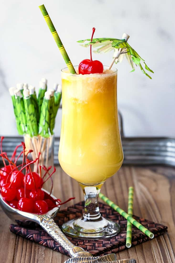 Pina Colada drink with garnish and straws