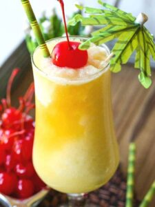 pina colada recipe with cherry and umbrella garnish