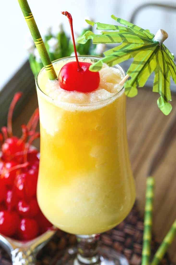 pina colada recipe with cherry and umbrella garnish