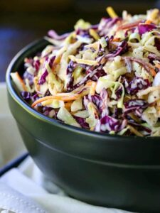 Coleslaw in a black bowl from the side