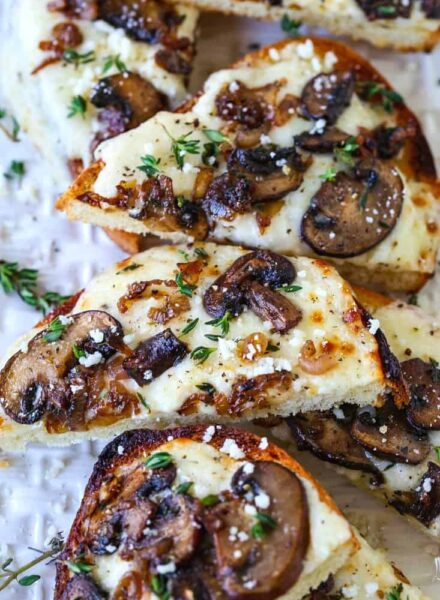 Mushroom and Thyme Cheese Bread appetizers sliced on platter