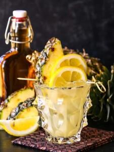 Whiskey lemonade cocktail with pineapple garnish