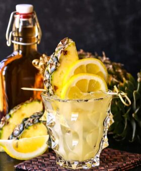 Whiskey lemonade cocktail with pineapple garnish