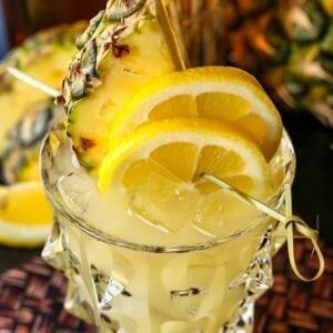 Pineapple Whiskey Lemonade with fresh pineapple garnish