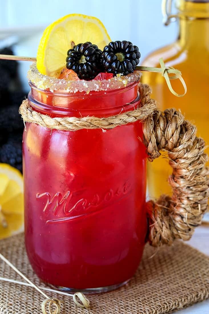 blackberry bourbon lemonade in mason jar glass