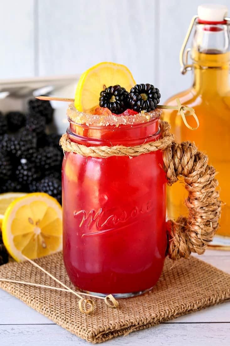 Blackberry bourbon lemonade in a mason jar glass