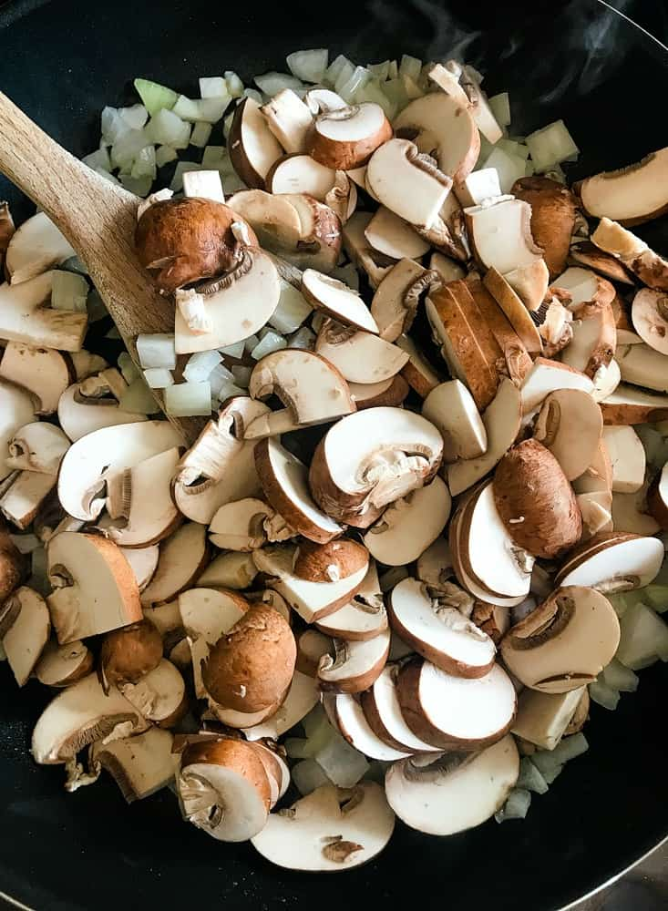 Mushrooms and onions in a skillet for casserole recipe