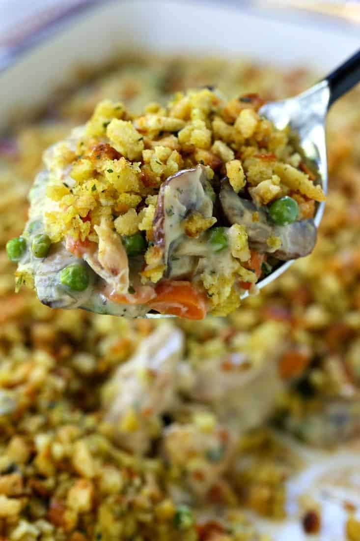Chicken and Stuffing Casserole on a serving spoon