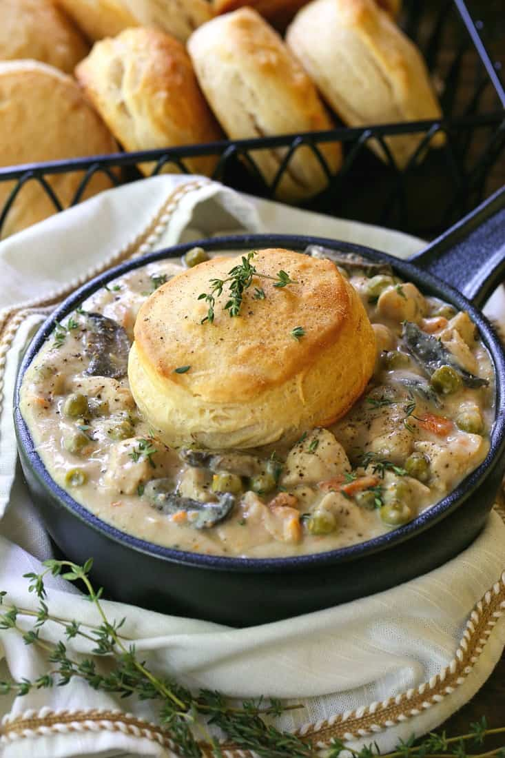 Chicken pot pie in a crock with a biscuit