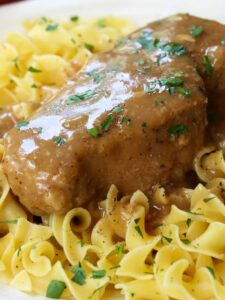 slow cooker pork chops with brown gravy and noodles