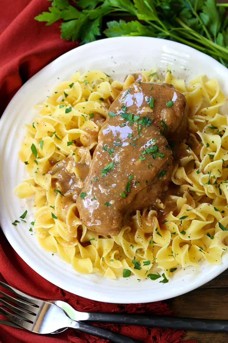 pork chops covered with brown gravy