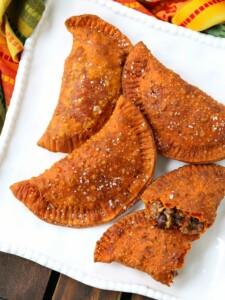 beef empanadas on a white platter