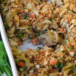 Tuna Noodle Casserole with cracker topping in baking dish