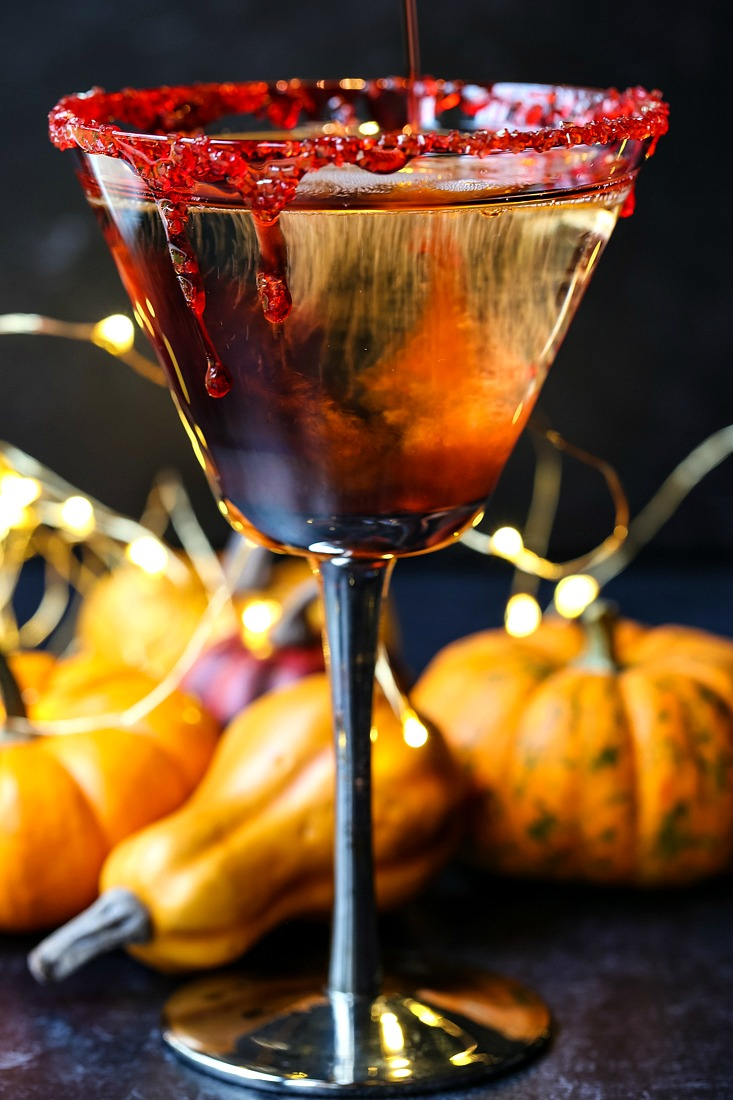 Vampire's Kiss Martini recipe with pumpkins in background