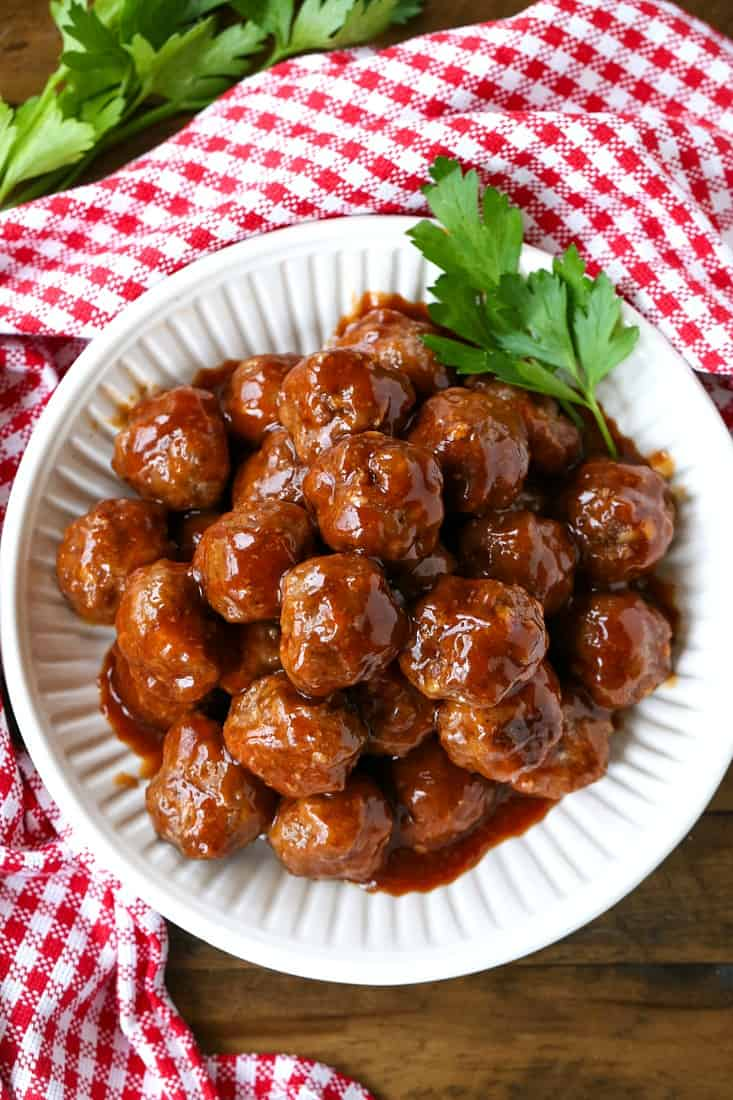 cocktail meatball recipe in a white bowl with parlsey