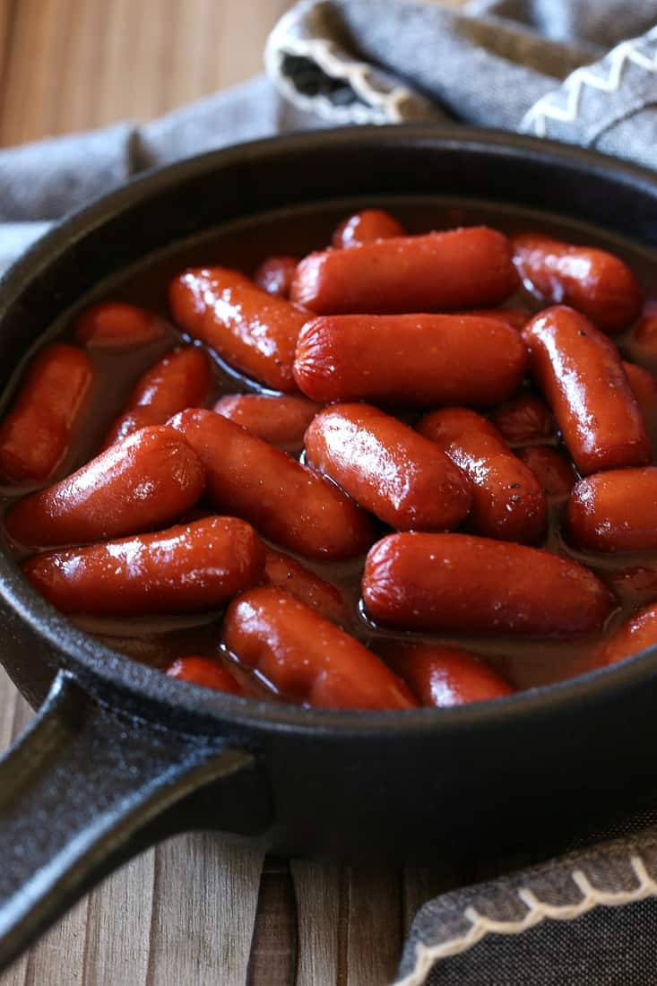 Little Smokies in a cast iron skillet for serving