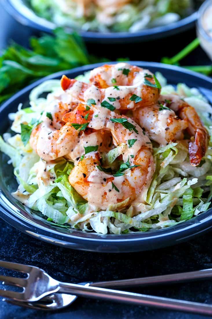 Shrimp Remoulade recipe over lettuce on gray plate