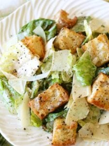 Homemade caesar salad dressing tossed with romaine