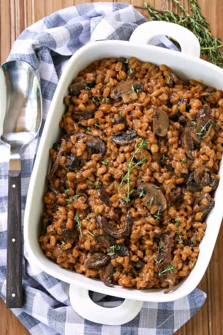 Farro recipe with mushrooms in a white casserole dish