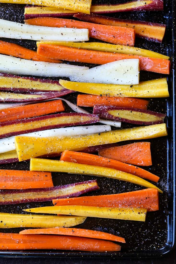 carrots on a baking sheet before roasting