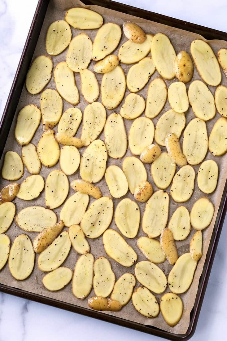 sliced fingerling potatoes on a baking sheet