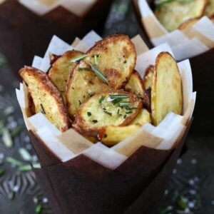 Roasted fingerling potatoes in paper cups with fresh roasemary
