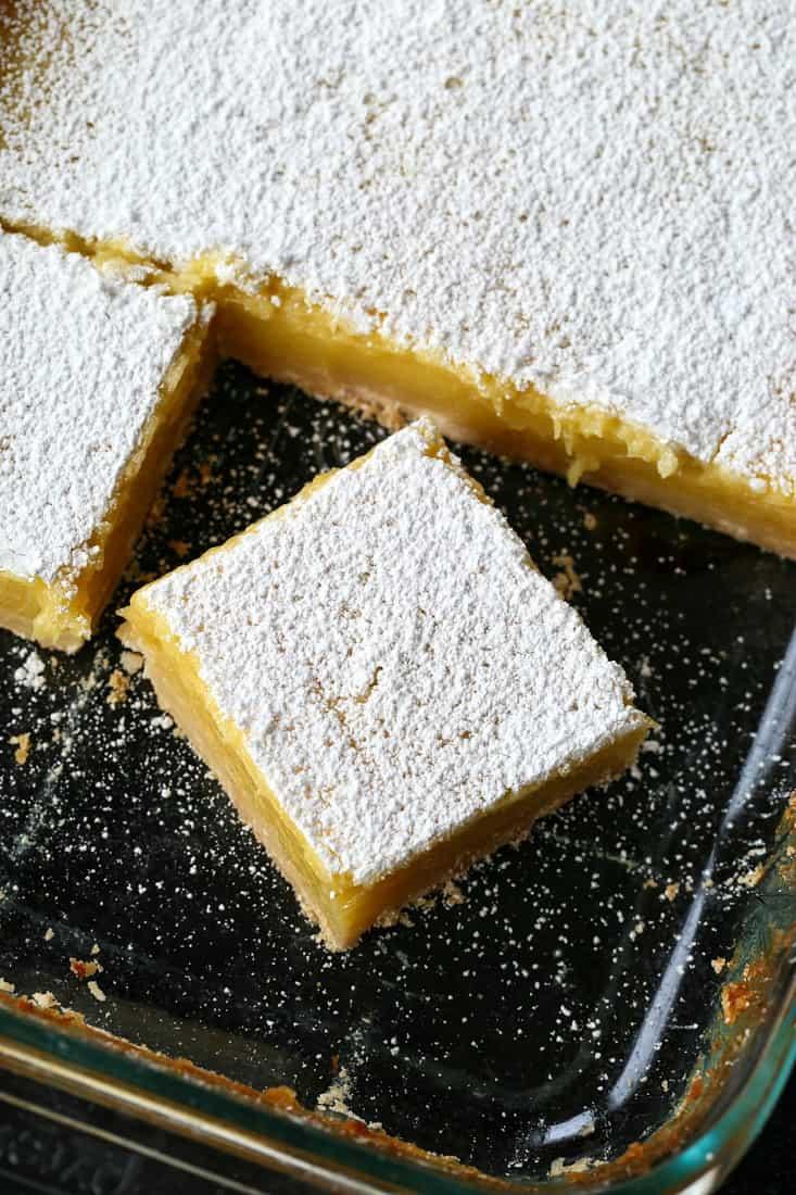 lemon bars cut in a baking dish