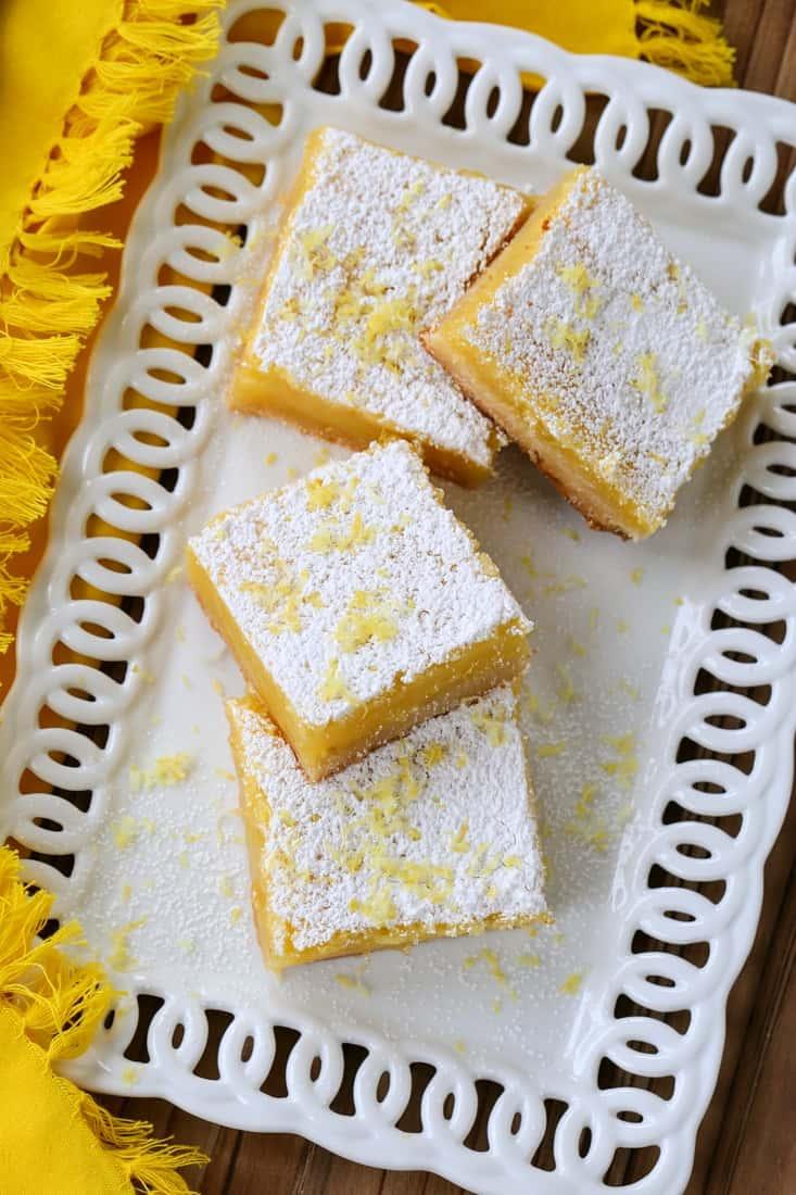 Limoncello Lemon Bars on a white platter