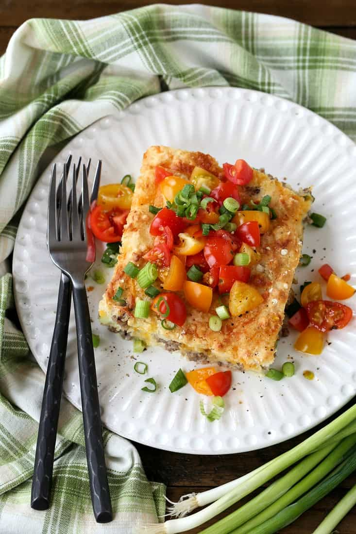 Slice of breakfast casserole recipes on plate with fork