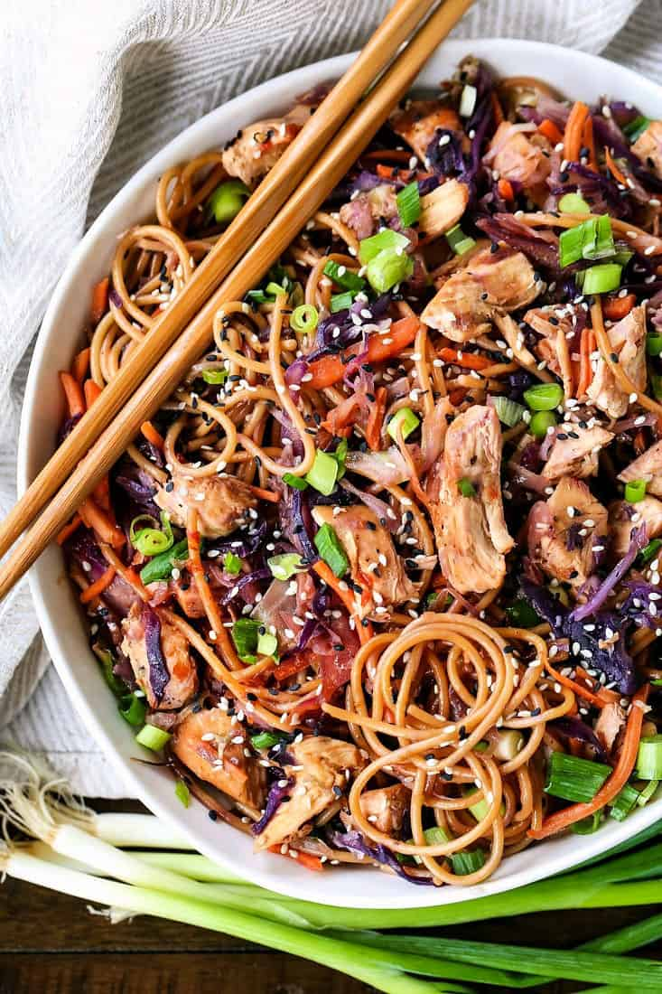 Teriyaki Noodles in a bowl with chop sticks and scallions